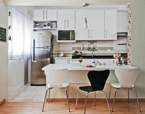 fotos de cozinhas para apartamento pequeno 500x393 - A mais belas cozinhas para apartamento pequeno, tudo com móveis planejados