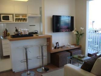 cozinha americana com sala de tv