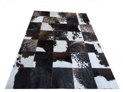 tapetes recortados de pele de boi 410x308 - Decorando com Tapetes de pele de boi para sala