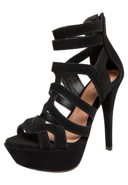 sandalia com tiras alta meia pata 410x594 - Sandálias de tiras altas Gladiadoras encantadoras